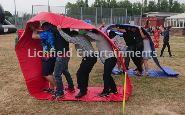 Human Caterpillar Racing game for hire for Team Building events