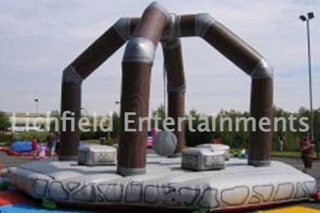 Human Demolition Wrecking Ball Inflatable for hire. Medieval themed inflatable game